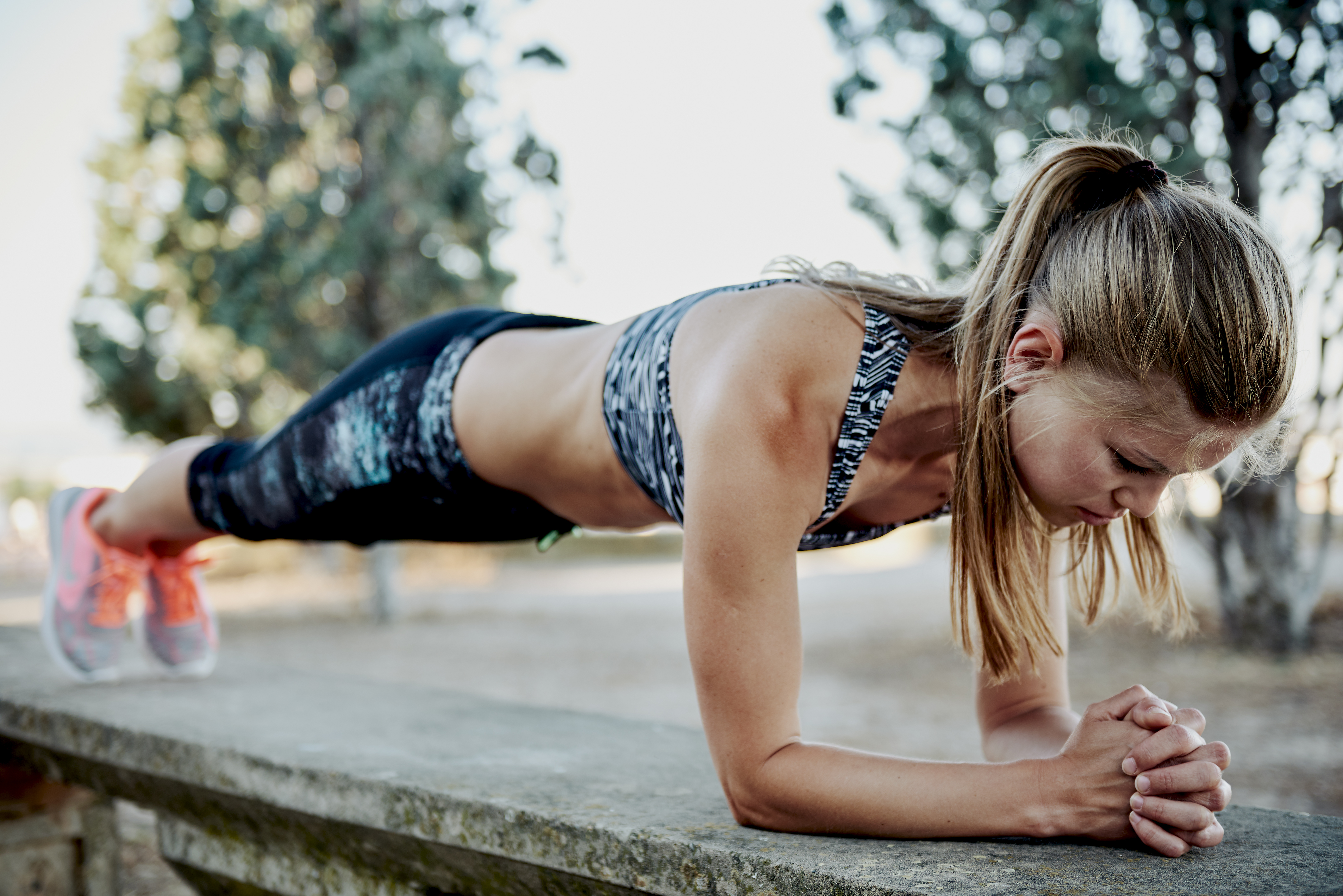 Blonde woman doing plank